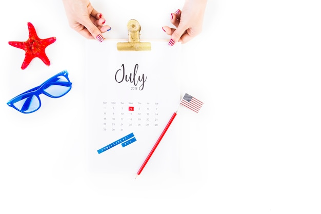 Usa independence day concept with hands touching calendar
