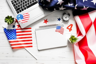 Usa independence day concept with notepad and laptop