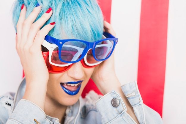 Usa independence day concept with punk woman with three sunglasses