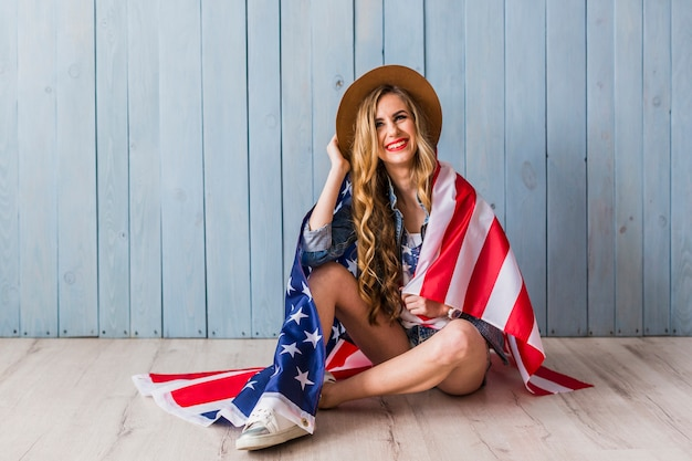 Usa independence day concept with woman covered in flag