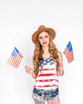 Usa independence day concept with woman holding two american flags