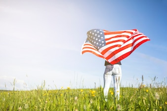 Usa independence day concept with woman on grass