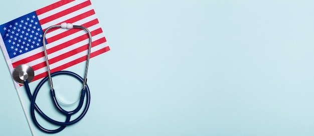 Usa medicine background stethoscope on the american flag healthcare and medical services in the usa concept high quality photo