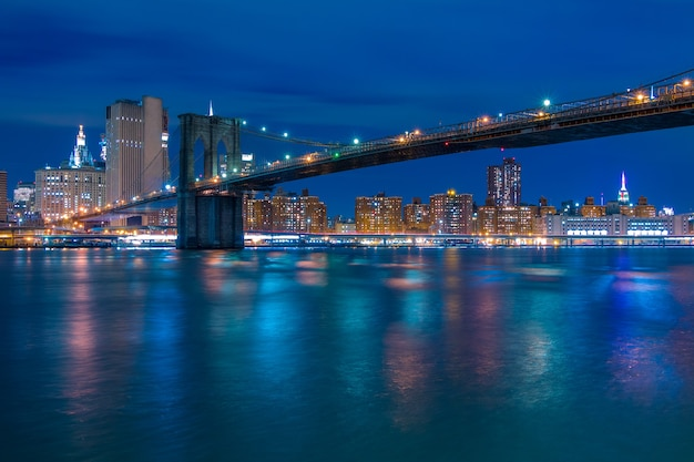 Usa. new york city. night. brooklyn bridge and night embankment of manhattan