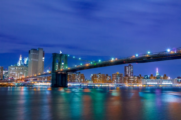 Usa. night new york city. brooklyn bridge and manhattan