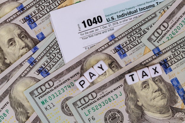 Usa tax form 1040 with us dollar bills