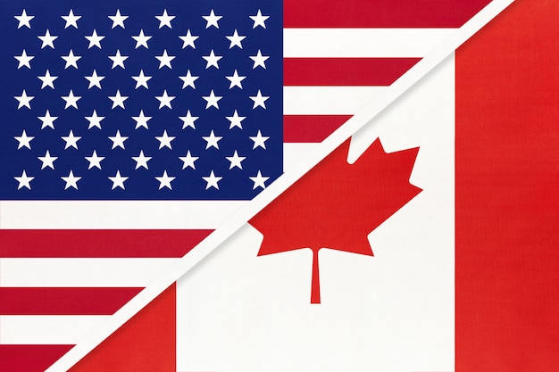 Usa vs canada national flag. relationship between two countries.