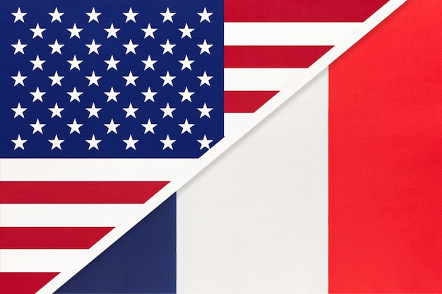 Usa vs france national flag from textile. relationship between american and european countries.