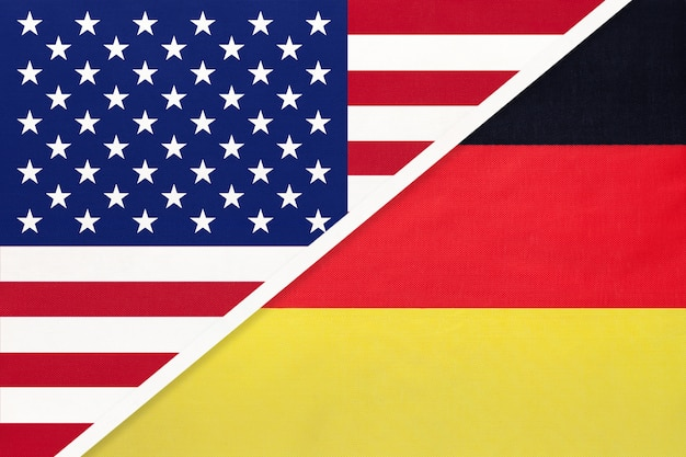 Usa vs germany national flag from textile. relationship between american and european countries.