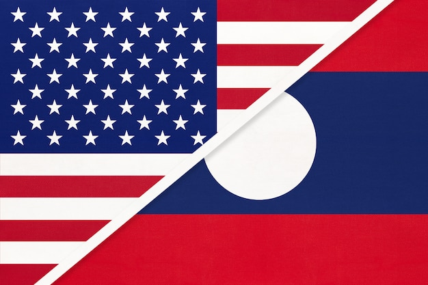 Usa vs laos national flag from textile. relationship between two american and asian countries.