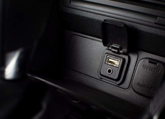 Usb and aux ports for connecting multimedia players in luxury car.