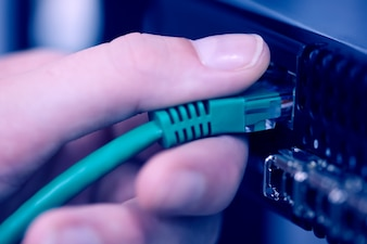 USB cable being inserted into server