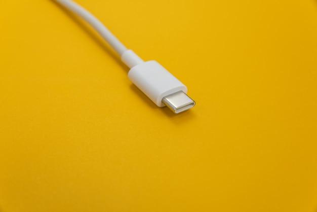 Usb cable type c over orange background