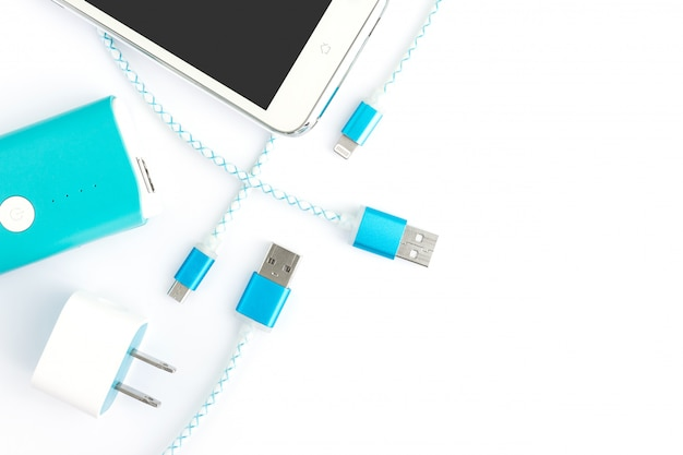 Usb charging cables with smartphone and battery bank in top view