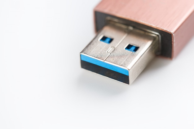 Usb flash drive 3 plug closeup on a white background. storage in computer memory