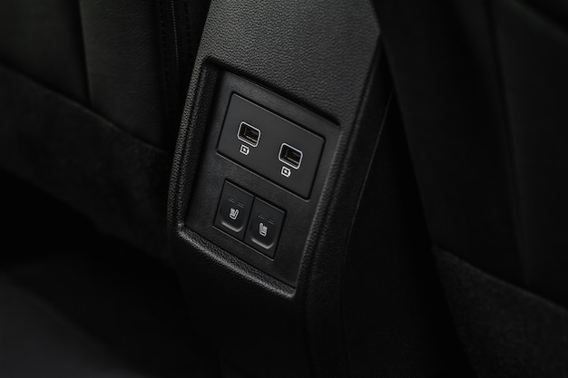 Usb port in the car panel close up. car interior detail. car usb charger detail.