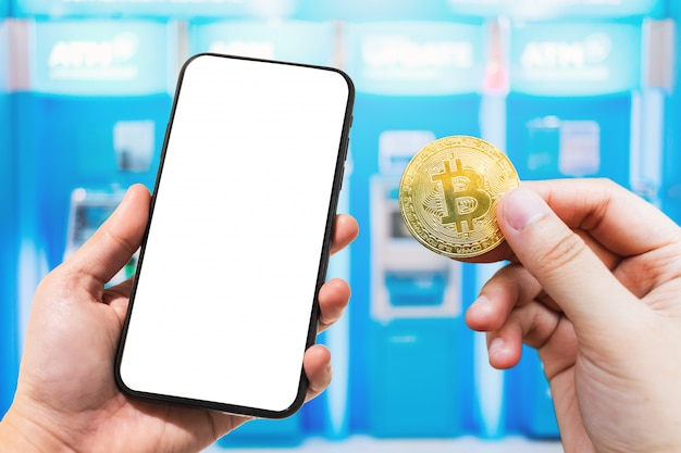 Use hand holding smartphone and bitcoin coin