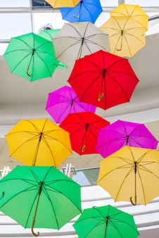 Used multi-colored open umbrellas for decoration