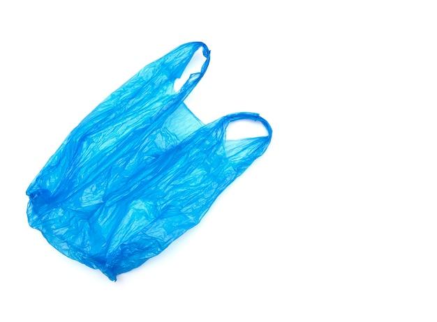 Использованный пластиковый синий пакет изолированные
