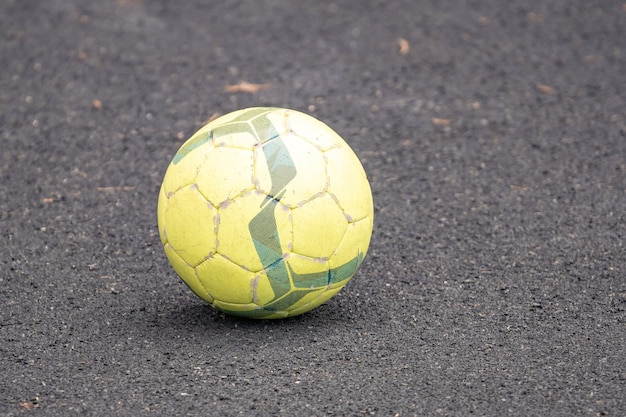 Used soccer ball on the playground