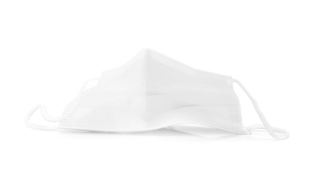 Used white medical protective face mask isolated on white background with clipping path