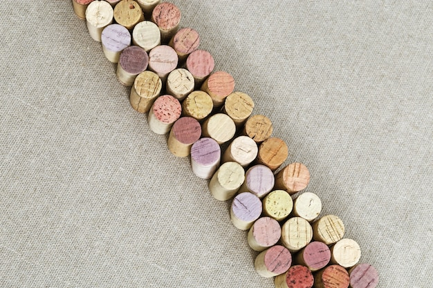 Used wine cork on linen cloth  with copy space.
