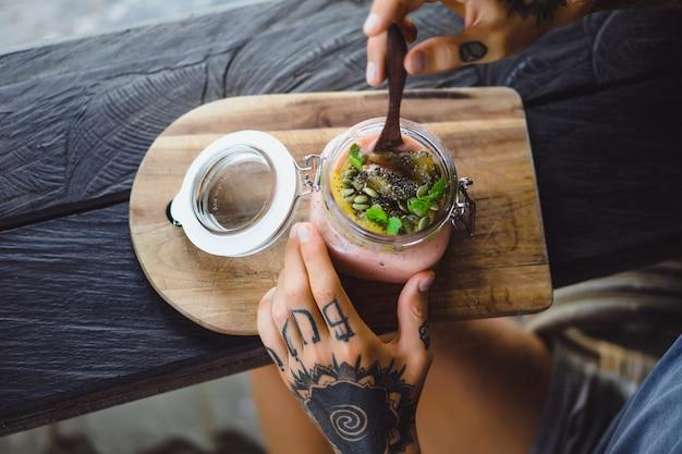 Useful breakfast. a beautiful breakfast feed, men's hands in tattoos.