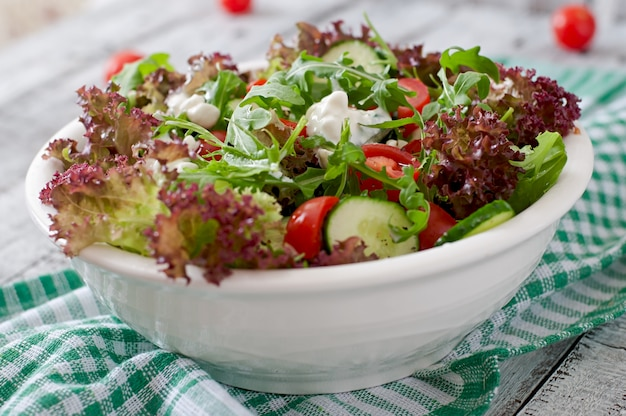 Useful dietary salad with cottage cheese, herbs and vegetables