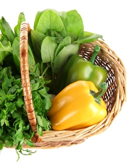 Useful herbs, mushrooms, and pepper in basket on white