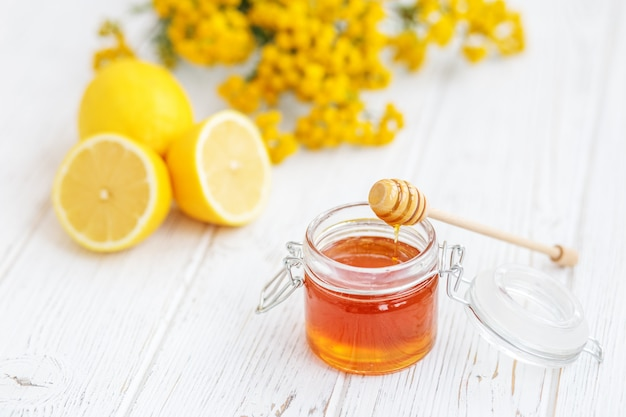 Useful honey and lemon. honey dipper.