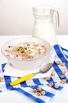 Useful oatmeal in bowl isolated on white