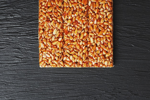 Useful snacks. fitness diet food. boletchik from kozinaki sunflower seeds, energy bars. top view. copy space