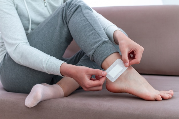 Using bactericidal medical adhesive plaster. foot skin care and prevention of corns and calluses. first band aid