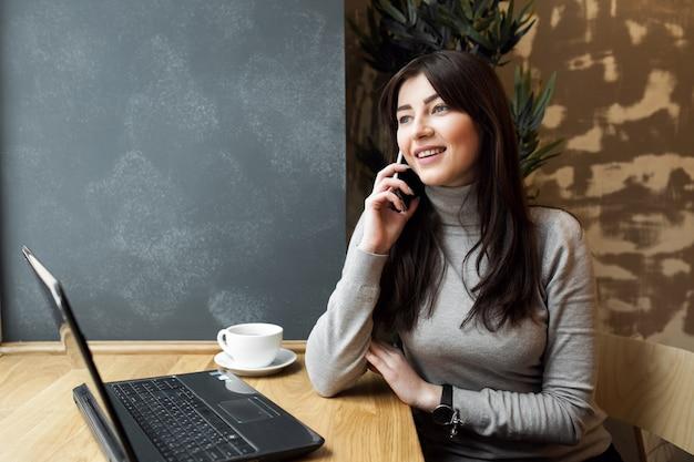 Using business laptop computer woman