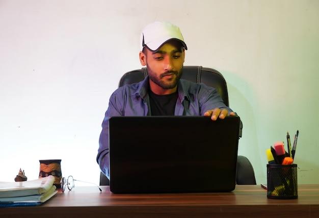 Using his laptop using his laptop