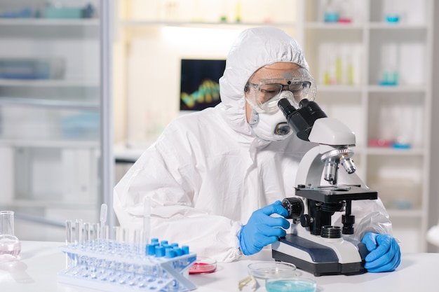 Using microscope to research infected blood sample