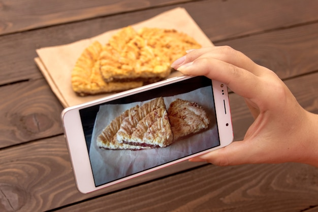 Using mobile phone to photograph the food