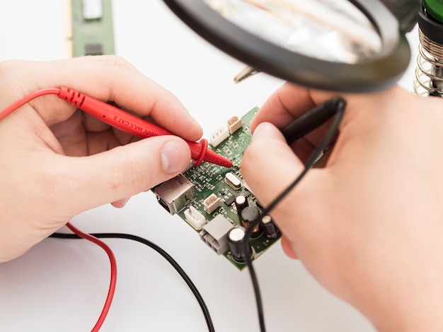 Using multimeter to check a circuit board
