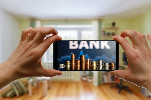 Using an online bank via smartphone at home.