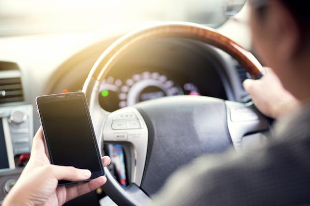 Using  smart phone mobile phone in car.