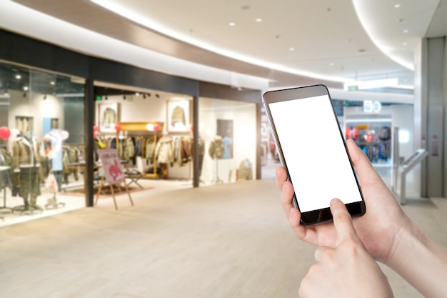 Using smartphone in a market or department store, closeup