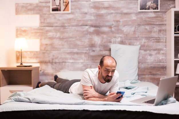 Using smartphone while laying on bed at night