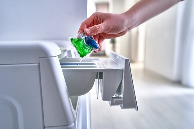 Using washing powder capsule for laundry clothes