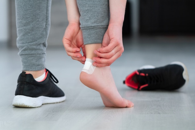 Using white medical adhesive plaster from calluses during wearing a new shoe