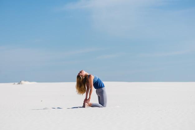 Ustrasana camel yoga pose in the desert