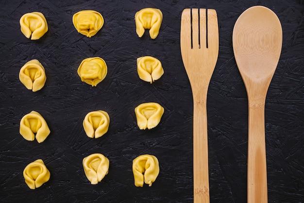 Utensils near stuffed pasta