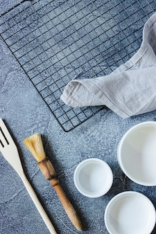 Utensils to prepare a cake on a textured blue surface. top view. copy space.