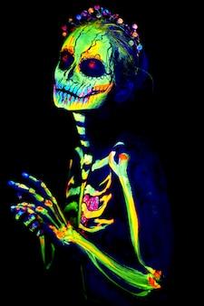 Uv body art painting of halloween female skeleton