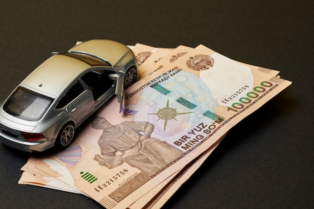 Uzbek sums and car toy concept of auto vehicle insuarance in uzbekistan
