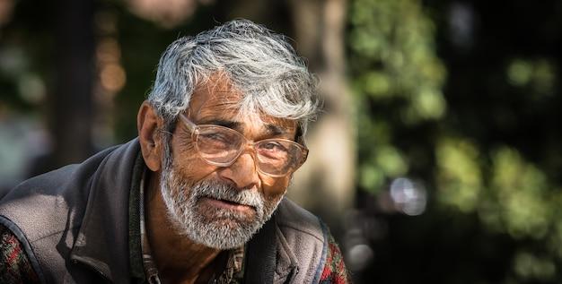 Uzhgorod, ukraine - apr. 19, 2019: homeless very old beggar man outdoors in city, asking for money donation.